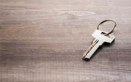 Single key on a wooden Board royalty free stock photo
