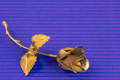 One Metal rose on a blue background for holiday greetings