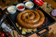 One meter long sausage on the plate served with sauces Stock Images