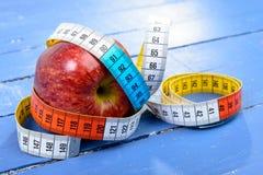 One meter ribbon around apple Stock Photo