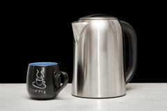 One mettal kettle and coffee cup Royalty Free Stock Photos