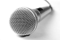 One microphone on white background. One silver microphone on white background royalty free stock photos