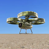 One military quadrocopter drone with  camera, camouflage paint  render Royalty Free Stock Image