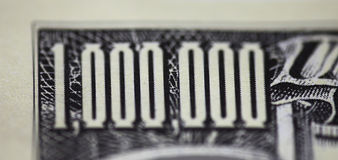 One million dollars. Macro closeup of a one million dollars note with shallow DOF to draw the viewer in royalty free illustration