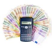 One million Euros. Paper money close up on white. One million Euros on calculator royalty free stock photo