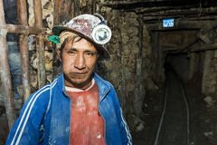 One miner at the entrance of the silver mine of the Cerro Rico in Potosi, Bolivia. Potosi, Bolivia - November 29, 2013: One miner at the entrance of the silver Royalty Free Stock Image