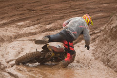 One minute i was on my bike,  and next minute Im  playing in the mud. Stock Photos