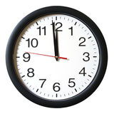 One Minute to 12 oclock. An isolated shot of a clock with one minute left to 12 royalty free stock photos