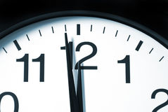 One Minute to 12 oclock. A macro shot of a clock with one minute left to 12 Stock Photo
