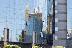One modern building reflection in another building. One modern building reflection in windows of another building Stock Photography