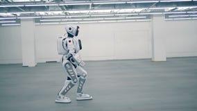 White droid, futuristic robot walking. Futuristic humanoid robot. One modern robot walking. 4K stock footage