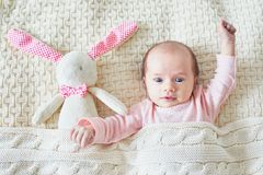 One month old baby girl with pink bunny stock photos