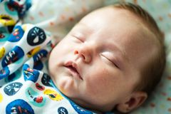 One month old baby sleeping peacefully Stock Photos