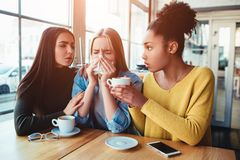 One more picture of sad girls where two of them are trying to support mentally their friend. She is crying beause of the. Fact she is preganat and it` not the Royalty Free Stock Photos