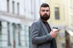 One more sip of coffee. City lifestyle. Businessman well groomed appearance enjoy coffee break out of business center. Urban background. Relax and recharge. Man royalty free stock photos