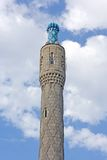 One mosque minaret tower isolated on sky backgroun Royalty Free Stock Image