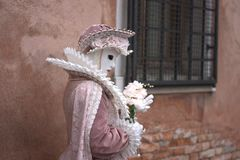 In romantic costume. One of the most beautiful carnivals in the world in the city, Venice, the most beautiful in the world stock images