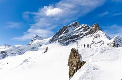 The view on the Jungfrau summit. This is one of the most beautiful summits in Europe. Jungfrau summit was located between between the northern canton of Bern and royalty free stock photography