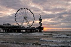 Pier with Ferris Wheel at the dutch coast near The Hague in Scheveningen, Holland royalty free stock image