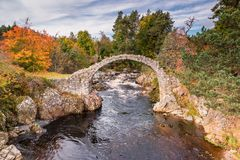 Carrbridge Packhorse Bridge in Autumn. One of the most iconic visitor attractions in the Cairngorms, the old packhorse bridge across the River Dulnain at Royalty Free Stock Photography