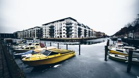 Boats in harbour, Copenhagen, Denmark. One of the most important streets in the middle of Copenhagen, Denmark Europe royalty free stock photography