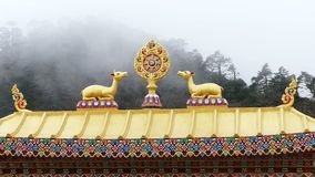 Dharma Wheel Tengboche Roof Clouds Foggy Buddhist Temple Khumbu Nepal Himalay. One of the most important symbols of Buddhism - Dharma Wheel on the background of stock video