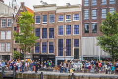 One of the most popular attractions in Amsterdam - the Anne Frank House and museum - AMSTERDAM - THE NETHERLANDS - JULY. One of the most popular attractions in stock photos