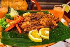 Crispy duck at Ubud, Bali, Indonesia. Dirty Duck. This is one of the most popular dishes in Bali featured in many media. It is half duck steamed in Indonesian Stock Photos