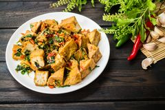 Spicy Fried Tofu with Basil Leaves stock photography