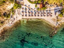 One of the most well known beaches in Greek island Thasos or Thassos town down aerial view. Aerial image of a beach in Aegean sea shot using a drone stock image