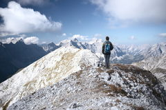 One mountain climber. Is standing on the top of a mountain Stock Photo