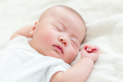 One mouth new born baby sleeping. Lying on bed Stock Image