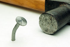 One nail and hammer Royalty Free Stock Image