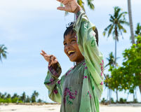One native child enjoying her dancing on beach Stock Images
