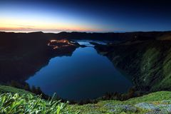 Colorful sunset over the Green and Blue Lakes seen from the Vista do Rei King's View, Sao Miguel island. One of the 7 Natural Wonders of Portugal - the stock photo