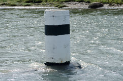 One navigation mark in the water Royalty Free Stock Photos