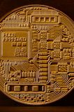 One new golden physical bitcoin is lies on dark wooden backgound, close up. High resolution photo. Cryptocurrency mining concep. T stock photo