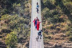 Resting in the height. One of the newest and longest suspension bridges in Pokhara. This spans across the Seti River royalty free stock photo