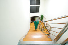 One of the nurses in the hospital to climb stairs. A nurse figure after hospital stairs Royalty Free Stock Image