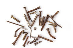One nut and old screws Stock Images