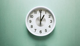 One o`clock. Wall clock shows time one o`clock Stock Image