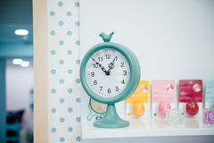 One o'clock on the blue wall clocks Royalty Free Stock Image