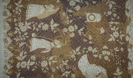 One of old Batik pattern with flowers and people illustration with brown and white color photo taken in Pekalongan. Indonesia java royalty free stock photography