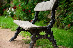 One old bench. In a flower garden Royalty Free Stock Photos