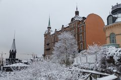 One of the old buildings of Stockholm Sweden on a winter day with snow. On the treetops stock image