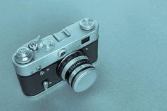 One old camera of blue monochrome tone Royalty Free Stock Images