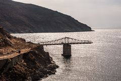 Bridge to nowhere above the sea stock images