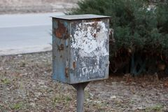 Old dirty metal box for electricity in the street. One old dirty metal box for electricity in the street stock photos