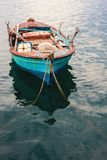 Old Fishing Boat. One old fishing boat with nets and other equipment in sea water Royalty Free Stock Images