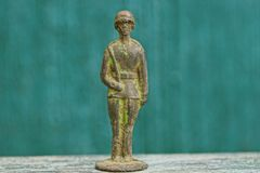 Free One Old Green Toy Tin Soldier Stands On A Gray Table Royalty Free Stock Images - 130542659